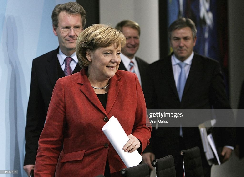 Lower Saxony State Governor Christian Wulff (L), German Chancellor <a gi-track='captionPersonalityLinkClicked' href=/galleries/search?phrase=Angela+Merkel&family=editorial&specificpeople=202161 ng-click='$event.stopPropagation()'>Angela Merkel</a> and Berlin Mayor Klaus Wowereit arrive to speak at a press conference after a meeting of German state governors at the Chancellery December 13, 2006 in Berlin, Germany. State governors from across Germany met in Berlin to discuss, among other issues, reforms to the German federal system as well as a national ban on smoking in restaurants, bars, hospitals and schools. Recent legislation failed after lawmakers could not decide whether the ban is a federal or state-level issue.