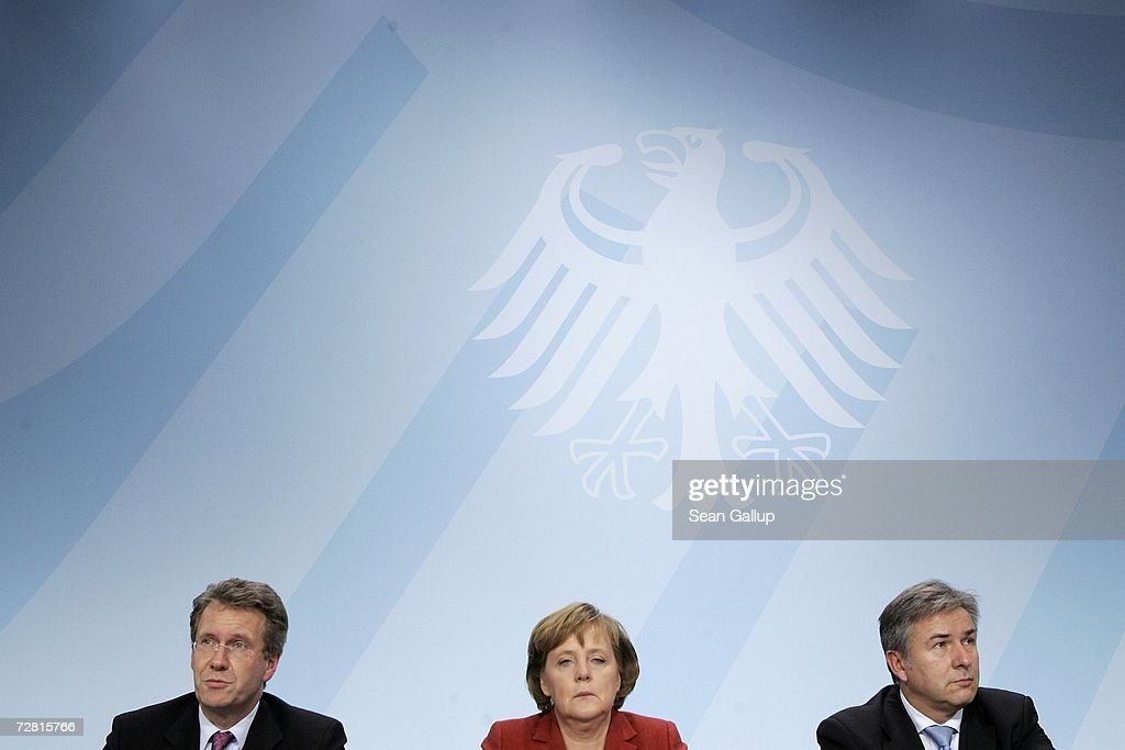 Lower Saxony State Governor Christian Wulff (L), German Chancellor <a gi-track='captionPersonalityLinkClicked' href=/galleries/search?phrase=Angela+Merkel&family=editorial&specificpeople=202161 ng-click='$event.stopPropagation()'>Angela Merkel</a> and Berlin Mayor Klaus Wowereit speak at a press conference after a meeting of German state governors at the Chancellery December 13, 2006 in Berlin, Germany. State governors from across Germany met in Berlin to discuss, among other issues, reforms to the German federal system as well as a national ban on smoking in restaurants, bars, hospitals and schools. Recent legislation failed after lawmakers could not decide whether the ban is a federal or state-level issue.