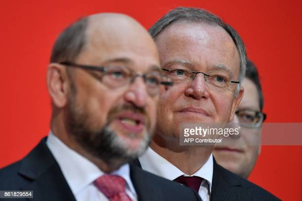 Lower Saxony's State Premier Stephan Weil winner of regional elections in his northwestern federal state listens to Martin Schulz leader of Germany's...