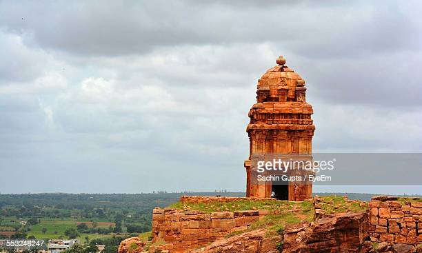 Lower Shivalaya Temple On Cliff Against Cloudy Sky