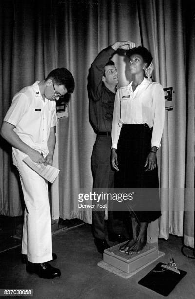 Lowery Air Force Base oneday Muster Zelda Thomas of Denver has her height and weight measured by Regan Purdy and Alain Boggs She is 5'6 1/2' Purdy...