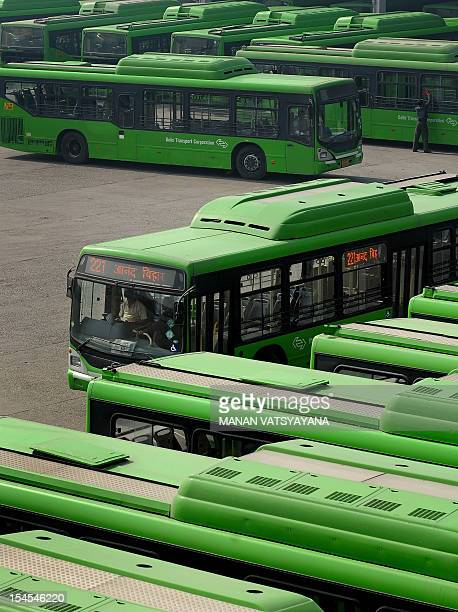 Lowfloor CNG buses of the Delhi Transport Corporation are seen parked at a bus depot in New Delhi on January 27 2010 AFP PHOTO/ MANAN VATSYAYANA