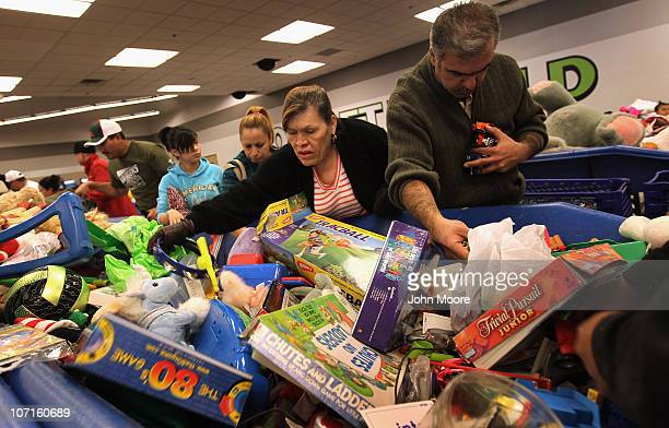 Lowincome shoppers search bins for toys at a Goodwill thrift store on Black Friday November 26 2010 in Denver Colorado People packed the thrift store...