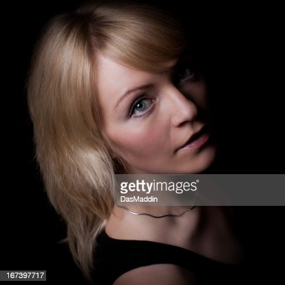 Lowkey portrait of a beautiful young girl looking into camera : Stockfoto