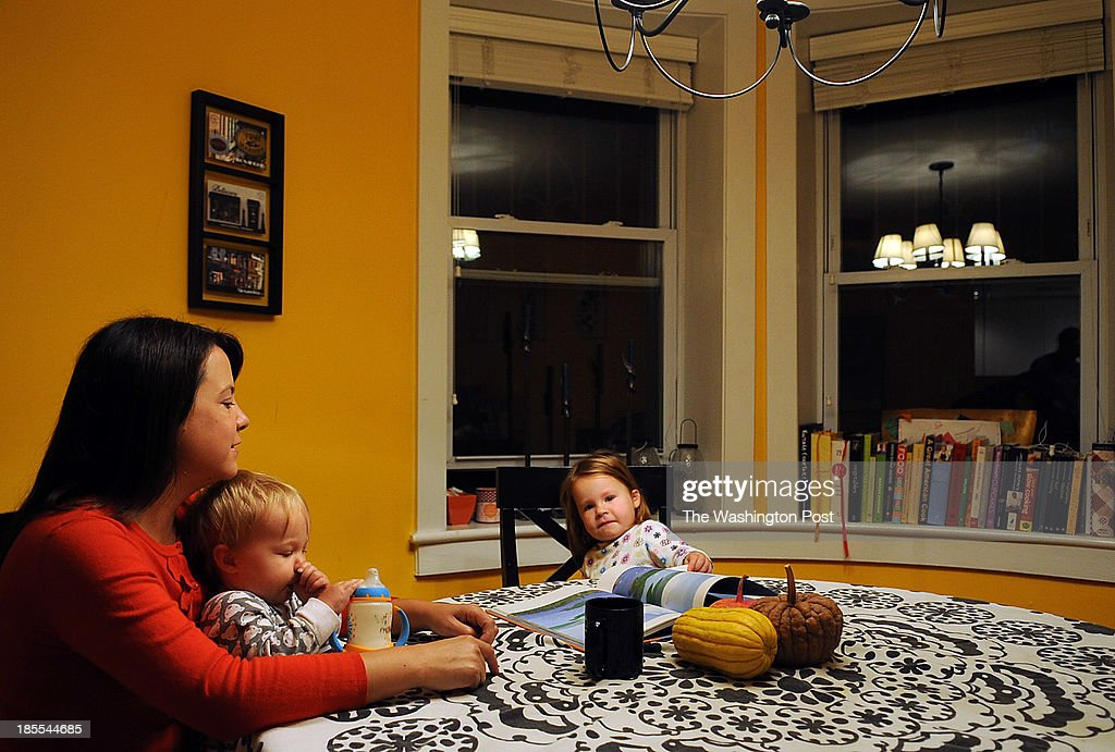 Lowrey Redmond, 37, spends some time with her two young daughters, Adele, 3, right, and Mabel, 1, during their morning routine at their family home in Logan Circle.