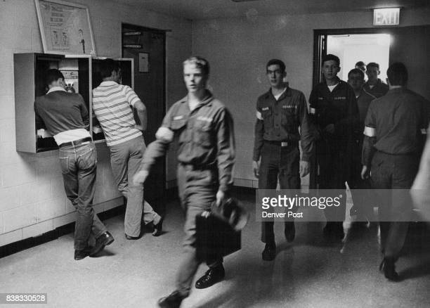 Lowry Airmen Returning From A Class Pass The Busiest Telephone Denver The phone at left generates more money than any of the thousands of other pay...