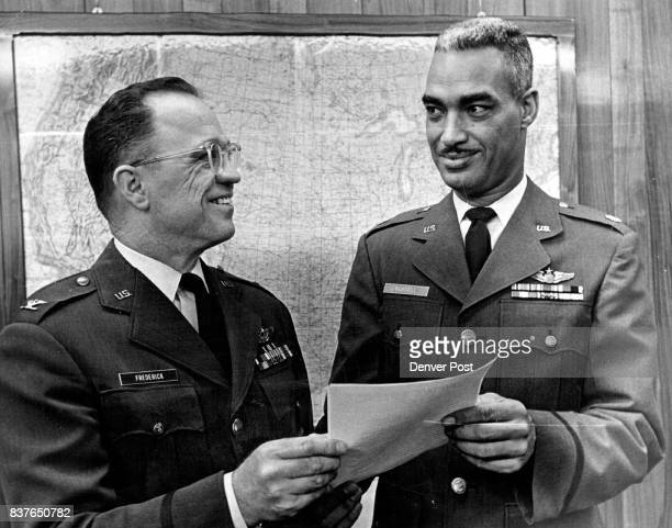 Lowry Supply Officer Honored Maj Otis C Russell right shows his citation by the US Air Force as an outstanding supply officer to Col Paul A Frederick...