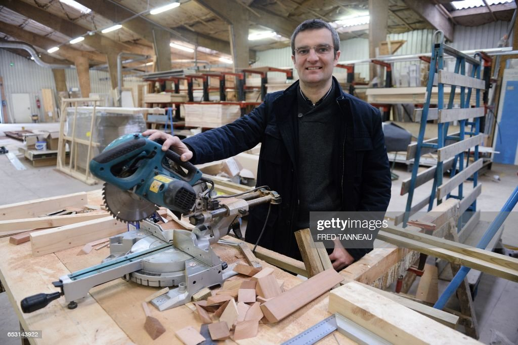 Loy and Cie CEO Fabien Hosteins poses at the factory of his company on March 1, 2017 in Plouay, western France. /