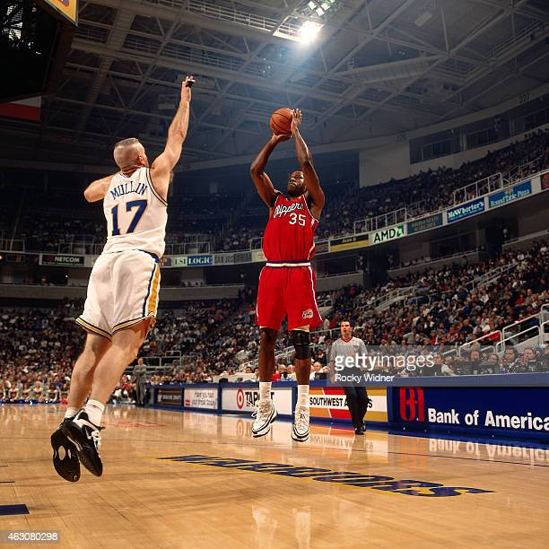 Loy Vaught of the Los Angeles Clippers shoots against the Golden State Warriors circa 1997 at the Arena in Oakland in Oakland California NOTE TO USER...