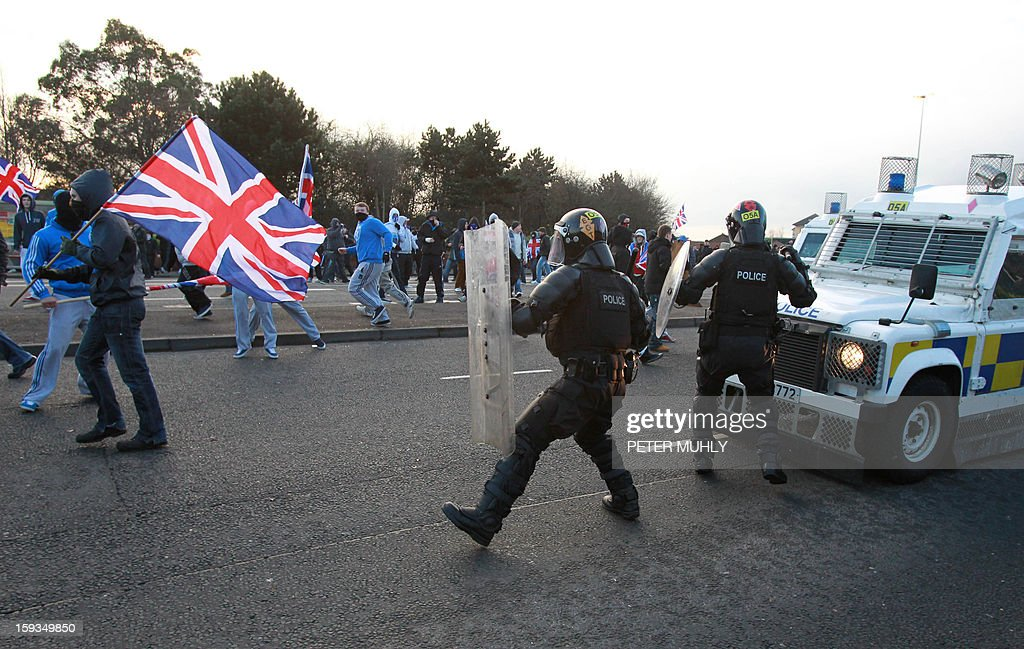 Loyalist protesters clash with police in east Belfast, Northern Ireland on January 12, 2013 after the latest loyalist march against the decision to limit the days on which the Union Flag would be flown over Belfast City Hall. Northern Irish demonstrators loyal to Britain clashed with nationalists and police on Saturday in fresh protests against curbs on flying the British flag, leaving four officers injured, police said. The clashes were the latest to blight the British province after more than five weeks of violent disorder over the flag issue.