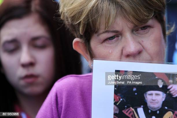 Loyalist protestors hold pictures of IRA Victims in Castlederg County Tyrone during the controversial parade by IRA supporters