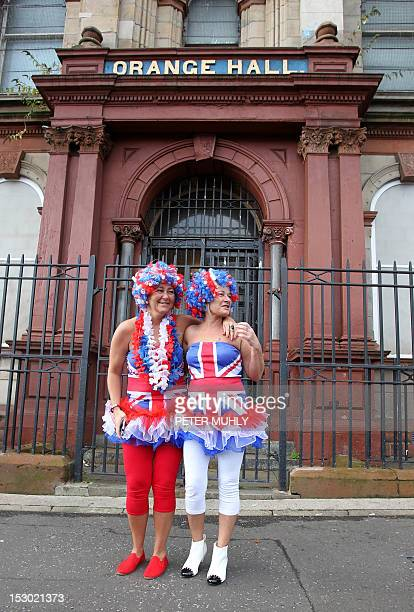 Loyalist supporters dress in Union flags clothes watch Orangemen from the Orange Hall in Belfast Northern Ireland on September 29 during one of...