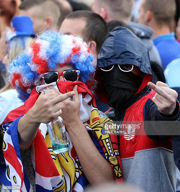 Loyalist supporters gesture at a police barricade at Woodvale Road after their parade was banned from marching past the Nationalist Ardoyne shops in...