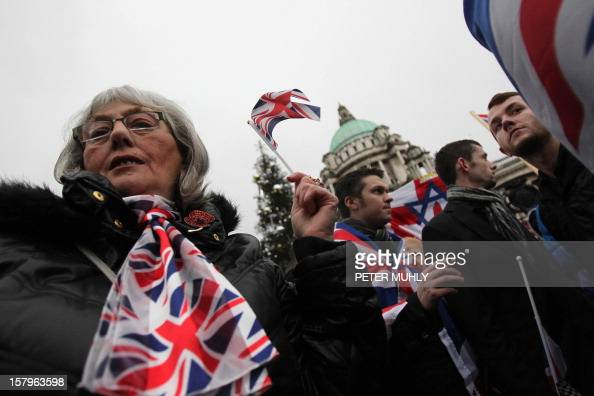 Loyalist waving the British Union Flag march outside city hall in protest over Belfast city council's decision to restrict the number of days the...