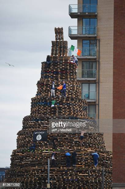 Loyalists finish the Sandy Row bonfire in preparation for the 11th night celebrations on July 11 2017 in Belfast Northern Ireland Tradition holds...