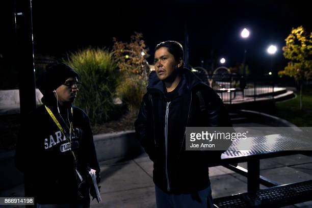 J Lozada a case worker for salvation army talks with Lamar Harvey of Arizona who has been in Denver about 3 years but has been on the streets for...