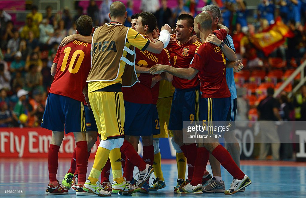 Lozano of Spain celebrates with team mates after winning the FIFA Futsal World Cup SemiFinal match between Italy and Spain at Indoor Stadium Huamark...