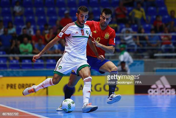 Lozano of Spain keeps pace with Bilal Bakkali of Morocco during Group F match play between Spain and Morocco in the 2016 FIFA Futsal World Cup at...
