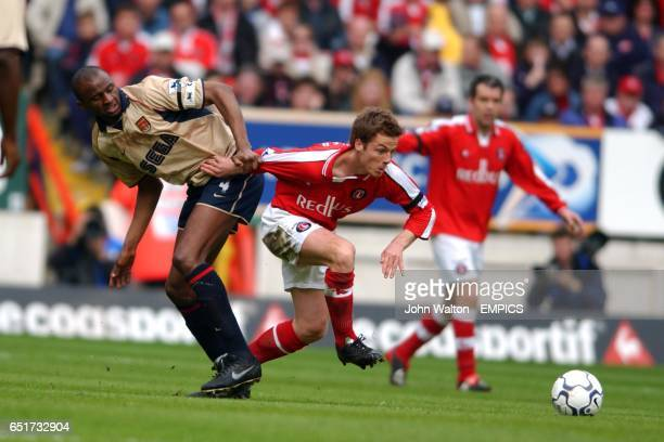 lr Arsenal's Patrick Vieira battles for possession of the ball with Charlton Athletic's Scott Parker