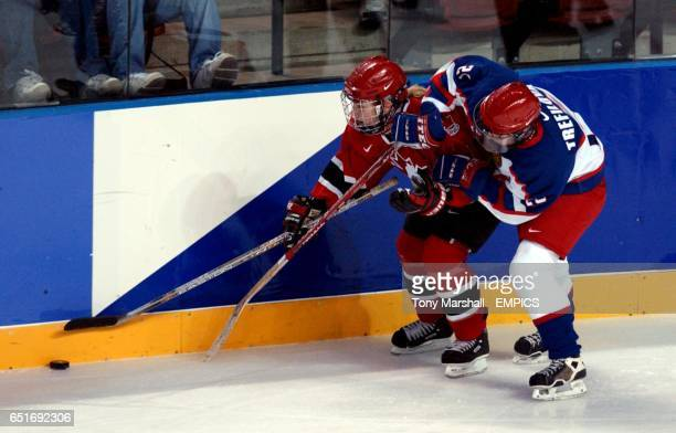 lr Canada's Cherie Piper is tackled by Russia's Svetlana Trefilova