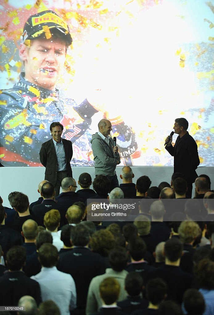 L-r Christian Horner and Adrian Newey speak with David Coulthard in front of the team at the Red Bull Factory on November 27, 2012 in Milton Keynes, England.