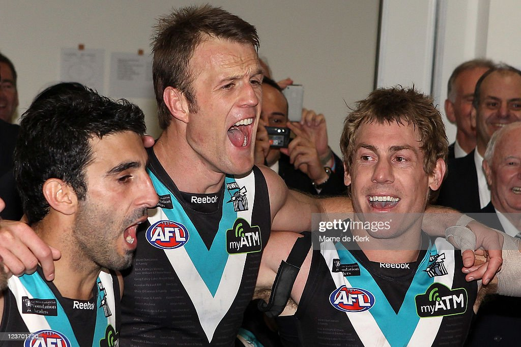 lr Domenic Cassisi Dean Brogan and Brett Ebert of the Power celebrate in the change rooms after the round 24 AFL match between the Port Adelaide...
