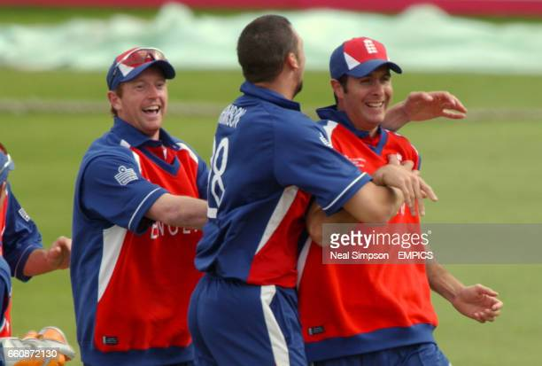 lr England's Paul Collingwood Steve Harmison and Michael Vaughan celebrate the wicket of Australia's Andrew Symonds