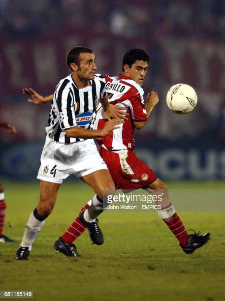 lr Juventus' Paolo Montero reaches the ball ahead of Olympiakos' Nery Alberto Castillo