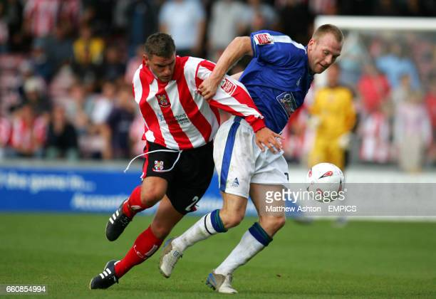 lr Lincoln City's Nathan Peat and Boston United's Simon Rusk