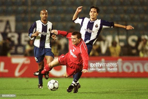 lr Liverpool's Vladimir Smicer is sent flying under the challenge from Porto's Paredes