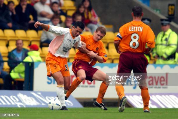 lr Livingston's Rolando Zarate battles for possession of the ball with Motherwell's Martyn Corrigan