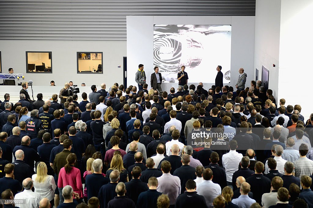 L-r Mark Webber, Christian Horner, Sebastian Vettel, David Coulthard and Adrian Newey speak with the team at the Red Bull Factory on November 27, 2012 in Milton Keynes, England.