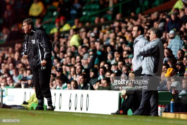 lr Motherwell's manager Terry Butcher urges on his team as Celtic's manager Martin O'Neill and assistant coach John Robertson watch the action