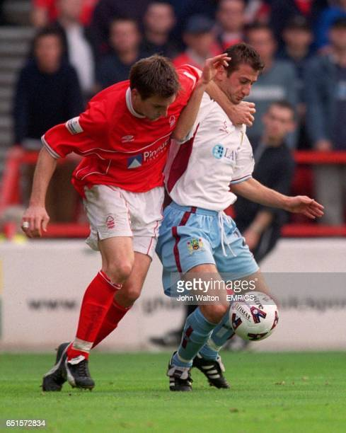 lr Nottingham Forest's Jim Brennan battles for possession of the ball with Burnley's Dimitrios Papadopoulos