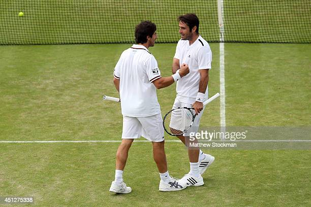 lr Pablo Cuevas of Uruguay and David Marrero of Spain during their Gentlemen's Doubles first round match against Colin Fleming and Ross Hutchins of...