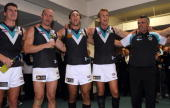 lr Paul Stewart Chad Cornes Troy Chaplin Dean Brogan Mark Williams of the Power celebrate after winning during the round six AFL match between the...