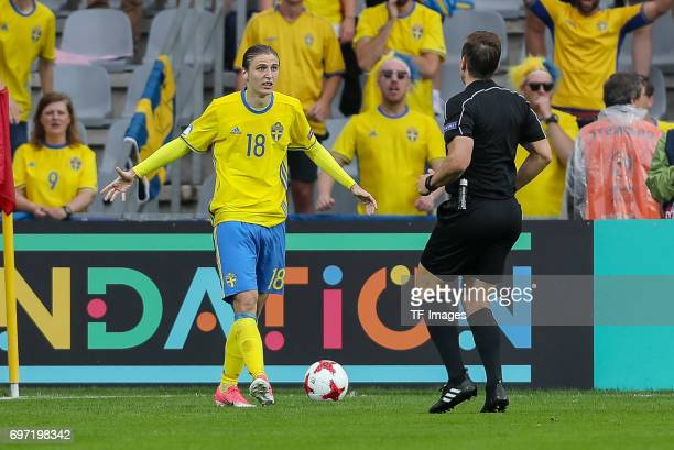 lr Pawet Cibicki of Sweden referee Tobias Stieler during the UEFA European Under21 Championship match between Sweden and England at Arena Kielce on...
