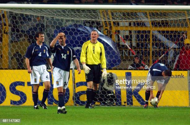 lr Scotland's Christian Dailly Maurice Ross Robert Douglas and Barry Ferguson stand dejected after the opening goal scored by Germany's Fredi Bobic