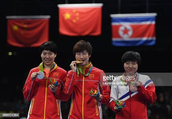 lr Silver medalist Li Xiaoxia Gold medalist Ning Ding of China and Bronze medalist I Song Kim of Democratic Peoples Republic of Korea pose during the...
