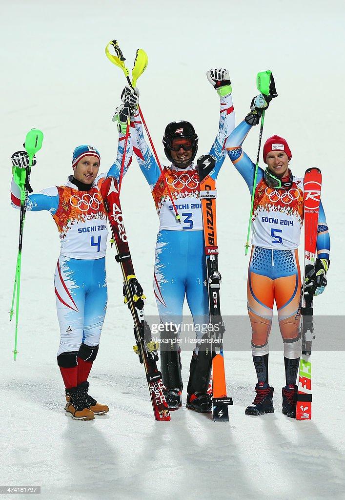 lr Silver medalist Marcel Hirscher of Austria Gold medalist Mario Matt of Austria and bronze medalist Henrik Kristoffersen of Norway celebrate after...