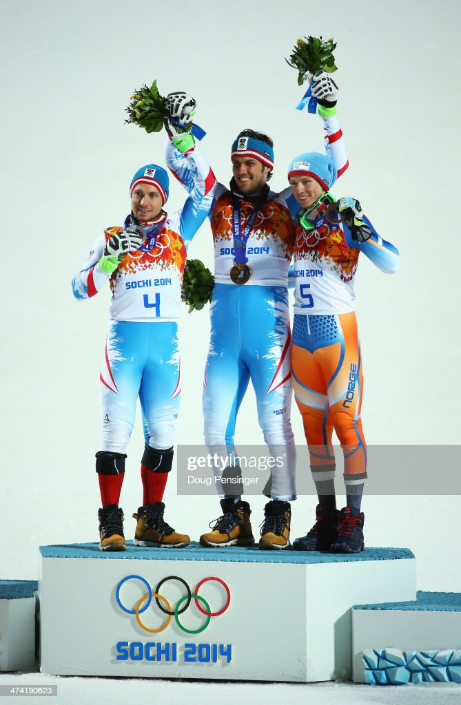 Silver medalist Marcel Hirscher of Austria, Gold medalist Mario Matt of Austria and bronze medalist Henrik Kristoffersen of Norway celebrate on the podium during the medal ceremony for the Men's Slalom during day 15 of the Sochi 2014 Winter Olympics at Rosa Khutor Alpine Center on February 22, 2014 in Sochi, Russia.