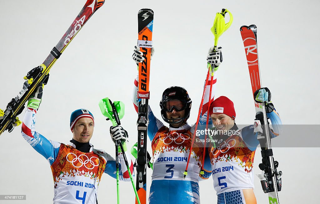 Silver medalist Marcel Hirscher of Austria, Golf medalist Mario Matt of Austria and bronze medalist Henrik Kristoffersen of Norway celebrate after the second round during the Men's Slalom during day 15 of the Sochi 2014 Winter Olympics at Rosa Khutor Alpine Center on February 22, 2014 in Sochi, Russia.