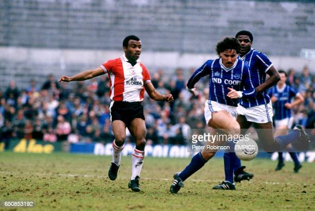 lr Southampton's Danny Wallace and Bobby Smith challenge each other for the ball as Leicester City's Bob Hazell looks on