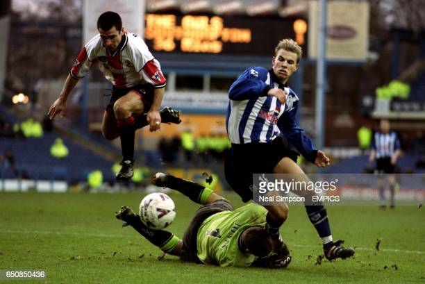 lr Southampton's Francis Benali and goalkeeper Paul Jones try to stop Sheffield Wednesday's Niclas Alexandersson