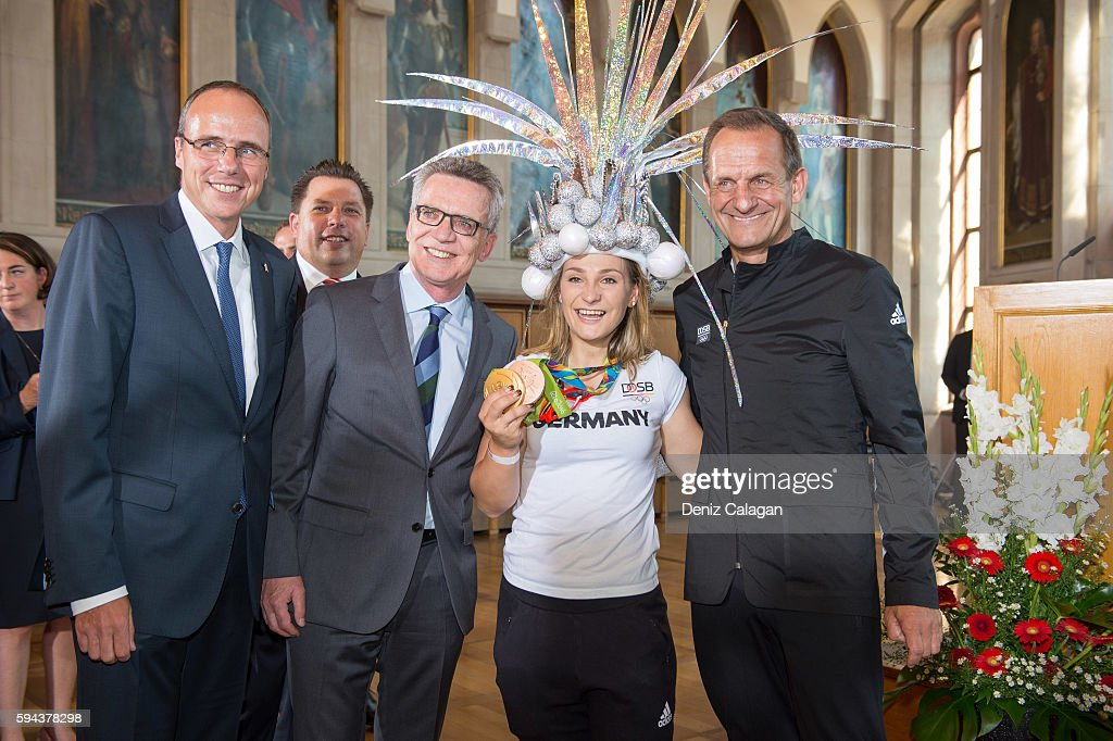 lr Thomas de Maiziere minister of the interior of Germany Kristina Vogel and DOSB president Alfons Hoermann pose on August 23 2016 in Frankfurt am...