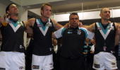lr Troy Chaplin Dean Brogan Mark Williams and Warren Tredrea of the Power celebrate after winning during the round six AFL match between the Adelaide...
