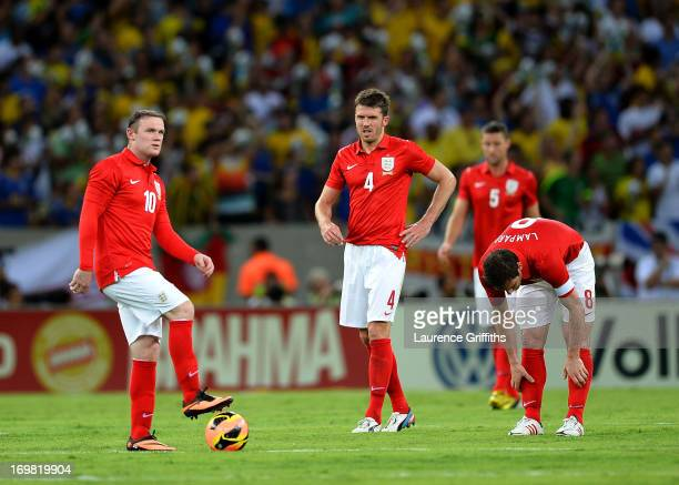 lr Wayne Rooney Michael Carrick and Frank Lampard of England show their dissapointment after Brazil@s goal during the International Friendly match...