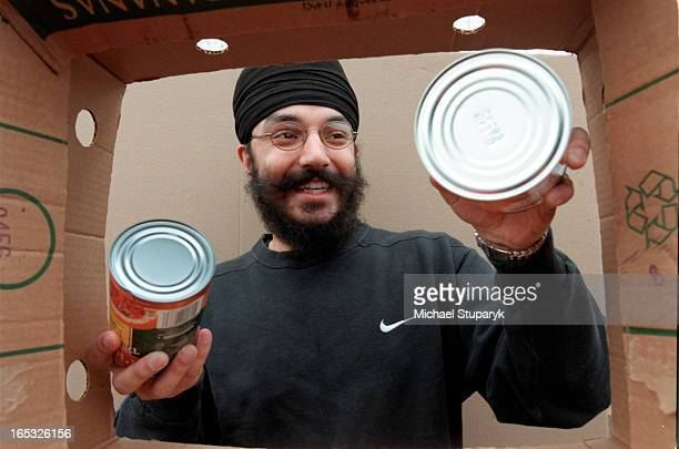 lst time volunteer Navdeep Singh from Maltonhelps out at the foodbank Putting cans into box