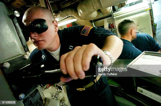 Lt Alex Baerg mans the parascope aboard the Trident submarine USS Georgia on October 7 2004 off the coast of Southern California The Georgia was...
