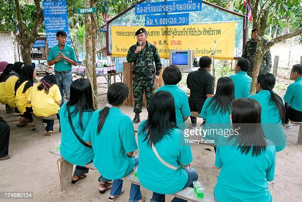 Lt Col Chalermpon from the Royal Thai Army teaches selfsufficient economy to a community of Muslim villagers The project is part of an effort led by...